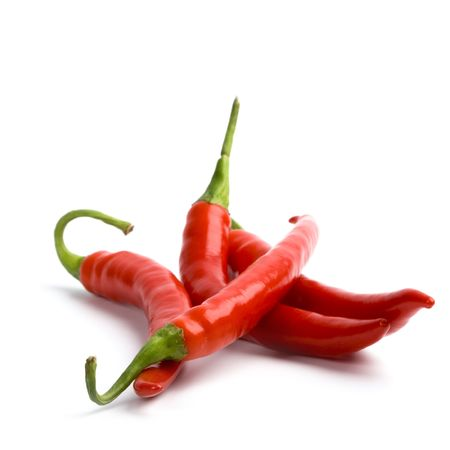 red chili pepper: four red chilly peppers isolated on white background