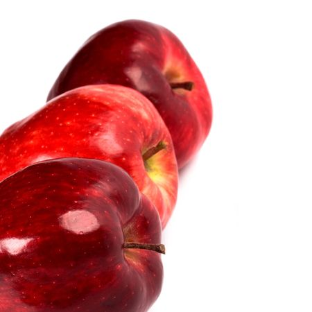 three red apples closeup on white background photo