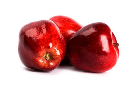 three red apples isolated on white background photo