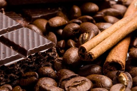 arrangement of chocolate, coffee and cinnamon sticks photo