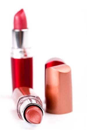 two lipsticks isolated on white background photo