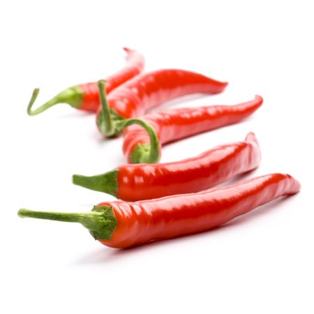 five red chilly peppers isolated on white background Stock Photo - 6284075