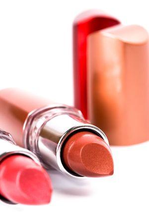 two lipsticks closeup on white background photo