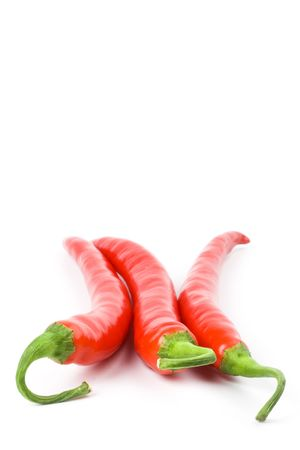 three red chilly peppers on white background Stock Photo - 6284138