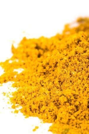 turmeric: pile of yellow turmeric closeup on white  Stock Photo
