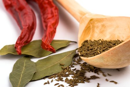 pimento, caraway and bay leaves closeup on white background photo