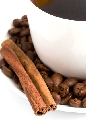 macro image of cup of coffee, cinnamon and beans photo