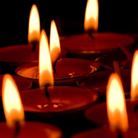 flaming candles group �n the dark background photo