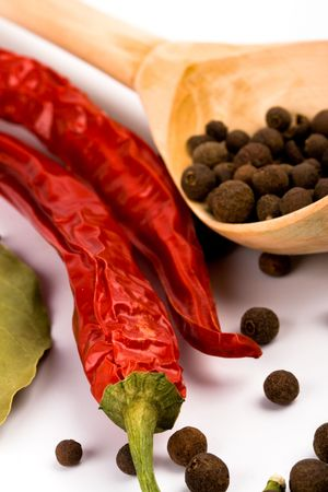 spices: pimento, aromatic pepper on wooden spoon closeup Stock Photo - 6309509