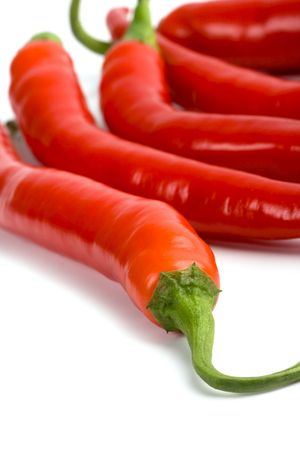 five red chilli peppers closeup on white background Stock Photo - 6309502