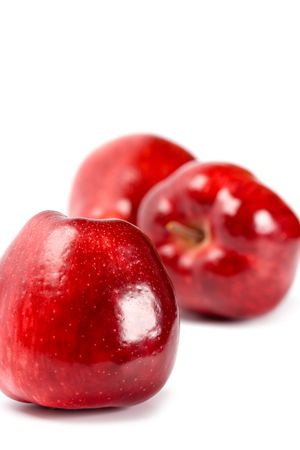 red apples closeup on white background photo