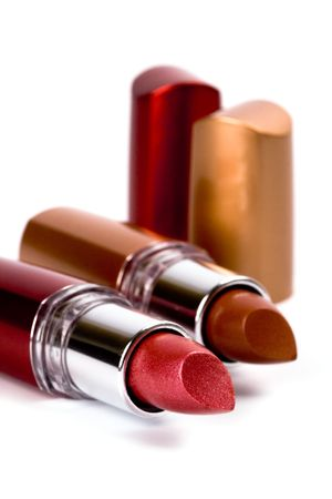 two lipsticks closeup on white background photo
