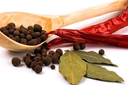 pimento: spices: bay leaves, pepper, pimento and wooden spoon closeup Stock Photo