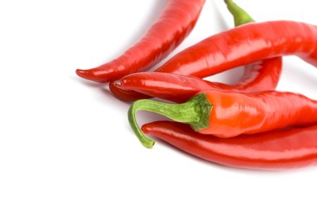 five red chilli peppers closeup on white background Stock Photo - 6363653