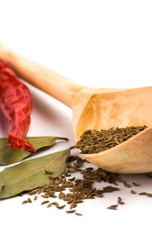 spices: pimento, caraway and bay leaves closeup on white background photo
