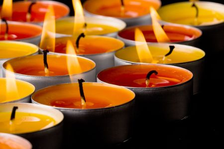 flaming candles on a dark background photo