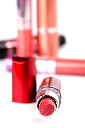 cosmetics: lipsticks and mascara closeup on white background photo