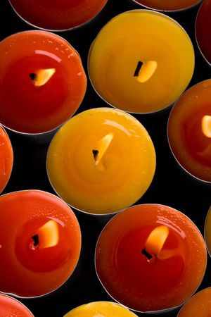 red and yellow flaming candles background photo
