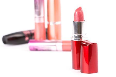 cosmetics: lipsticks and mascara closeup on white background photo