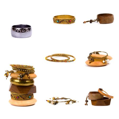 collection of metal and wooden bracelets isolated on white background