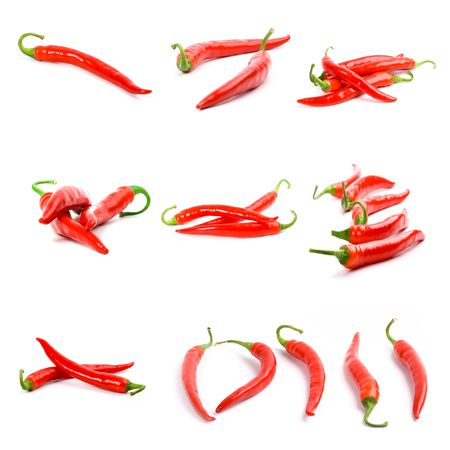 cayenne pepper: collection of red chili peppers isolated on white background