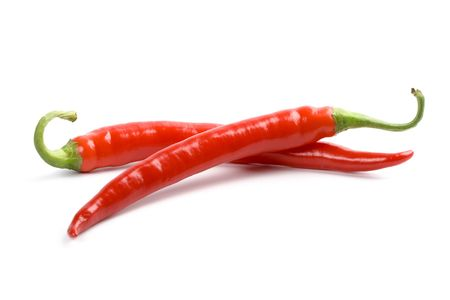 two red chili peppers isolated on white background Stock Photo - 6578600