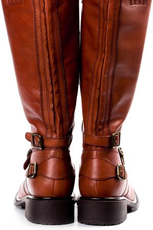 pair of brown boots closeup on whire background photo