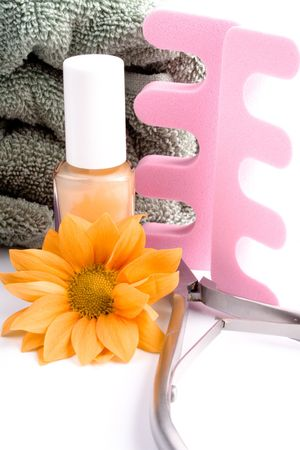 pedicure beauty set, flower and towel on white background photo