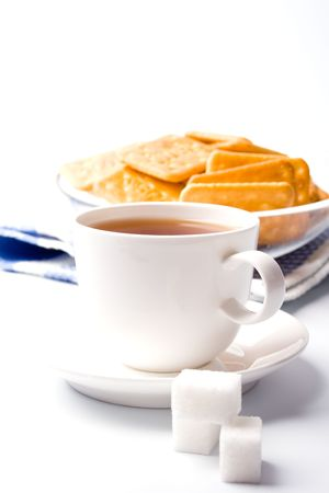 cup of tea, sugar and cookies closeup on white background photo