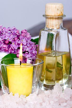 bath and spa items (towel, oil, salt, lilac, candle) photo