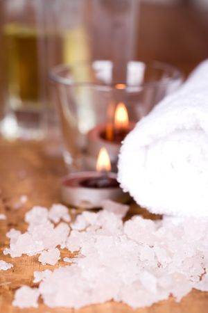 spa products (towel, salt, candles) on wooden background photo