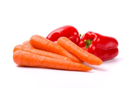 carrots and red paprika on white background
