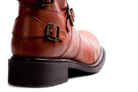 brown boot closeup on whire background Stock Photo