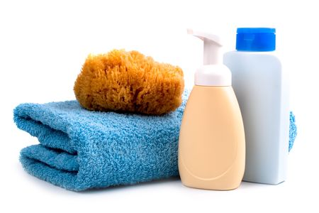 body care products and towel on white background photo