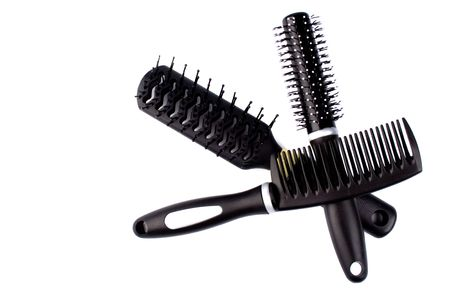 three hairbrushes on white background