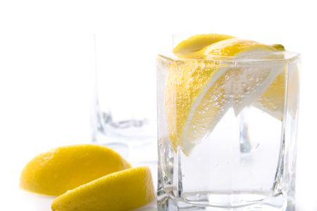 two glasses with soda water and lemon slices photo