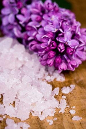 bath salt and lilac flower on wooden background photo
