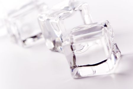 ice cubes closeup on white background photo