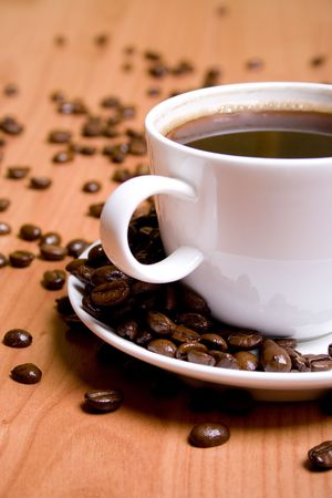 cup of coffee and beans on wooden table Stock Photo - 7074085