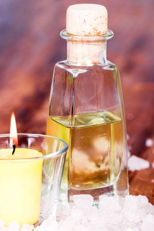 bath and spa items (oil, salt, candle) on wooden background photo
