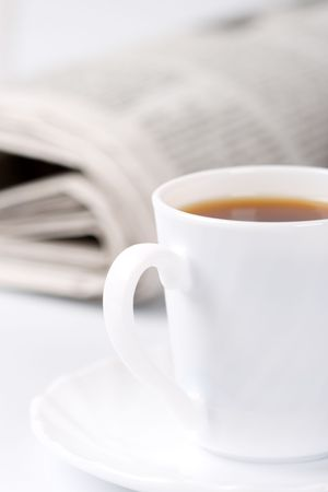 cup of coffee and stack of newspapers closeup Stock Photo