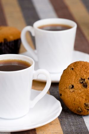 two cups of coffee and muffins closeup on textile background Stock Photo - 7103174