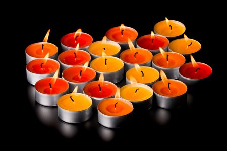 flaming candles on black background photo