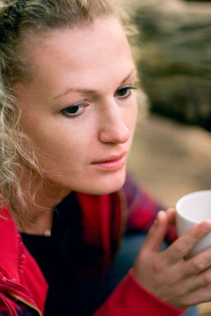 beautiful woman holding a cup of hot drink photo