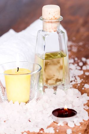 bath and spa items (towel, salt, oil, candle) on wooden background Stock Photo - 7147063