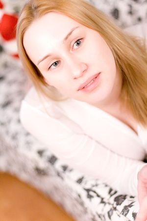 portrait of blond woman on the bed. Stock Photo - 7146968