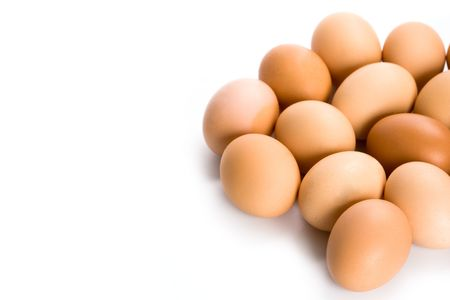 brown eggs closeup on white background photo