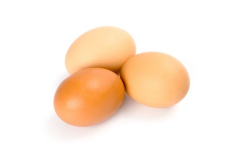 three brown eggs isolated on white background photo