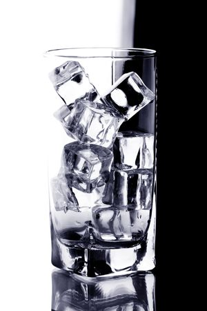 glass with ice water isotated on white an black background photo