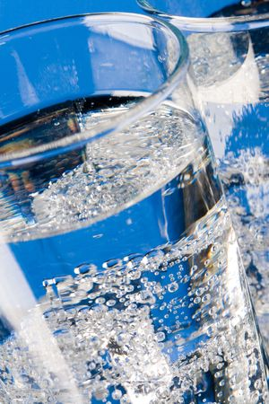 glasses with cold water closeup on blue background Stock Photo - 7208065